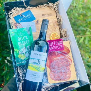 """ALL BRITISH"" for one of our favourite corporate clients @gcprojects_gascentre_solihull they treated their clients to a bespoke hamper graze this Christmas, with a bottle of red wine from the @threechoirsvineyard English vineyard, artisan charcuterie selection from @chilterncharcuterie , olives from @ollys.ollys and olive wood chopping boards sourced from @therusticdish laser engraved with the @gcprojects_gascentre_solihull logo in-house @spreadsandbreadsuk We loved creating these hampers and we've heard that the @gcprojects_gascentre_solihull clients love them too - yay!!! We created their personalised Christmas postcards, and branded each box with the help of @fabbyshabbydoodah Get in touch with us if you'd like us to create your business a bespoke graze/hamper for 2021! #grazingtables #grazingtable #grazingtablesandcheeseboards #grazing #grazingplatter #grazingboard #grazingbox #solihullbusiness #solihull #solihullfood #solihullfoodie #birminghambusiness #birminghamfood #birminghamfoodie #foodtrends #spreadsandbreads #foodporn #platters #partyfood #eventcatering #foodevents #foodgifts #spreadsandbreadssolihull #weddingcatering #weddingcaterer #partycatering #partycaterer @solihullcouncil @solihullforsuccess"