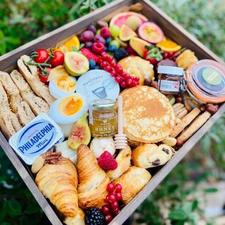 Sunday Birthday Brunch 🥐🍊🥞🍓🥚🫐🌰🍯 The POSSE wooden grazing tray brunch includes all our favourite produce perfect for a midmorning feast. Today's brunch graze includes a selection of fresh fruits, stack of buttermilk pancakes, freshly baked mini pastries, baklava, cakes and brownies, macrons, selection of yogurts, selection of cheese, soft boiled duck eggs, seeded bagel thins, mini pots of @philadelphia_uki , mini pots of @nutellauk , mini pots and drizzle stick from @matersandco and lots of other hidden treats! Delivered with flowers from @urbandesignflowers #grazingtables #grazingtable #grazingtablesandcheeseboards #grazing #grazingplatter #grazingboard #grazingbox #solihullbusiness #solihull #solihullfood #solihullfoodie #birminghambusiness #birminghamfood #birminghamfoodie #foodtrends #spreadsandbreads #foodporn #platters #partyfood #eventcatering #foodevents #foodgifts #spreadsandbreadssolihull #weddingcatering #weddingcaterer #partycatering #partycaterer @solihullcouncil @solihullforsuccess