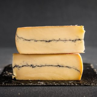 BOUNCY. NUTTY. FARMYARDY.   Our September Cheese feature - Morbier cheese is a semi soft french cheese with a layer of ash in.   Brine washed it is a medium strength cheese. Morbier was traditionally made with the left over milk used to make Comte (as it takes about 50l to make one of those!) This milk was put into a mould and sprinkled with wood ash to deter pests and moulds.  The cheese would be topped up with the mornings milk, giving the distinctive line of ash that runs through the cheese.  Washed in brine as it matures, the sticky fragrant rind is formed with sometimes a slightly crunchy texture - its all perfectly edible! The farmers discovered that as the Morbier takes a much shorter time to mature than the Comte`, it was actually a good source of income and so the Morbier industry was born. Made in the Moez region of the Jura Mountains, Morbier is a lovely fruity semi hard cheese with a fairly delicate but distinctive flavour and a lovely fragrant rind.  We recommend a nice Burgundy with Morbier as both have strong flavours that stand up to one another.  We source our Morbier cheese from @mousetrapcheese   🧀 🥨🍇  #grazingtables #grazingtable #grazingtablesandcheeseboards #grazing #grazingplatter #grazingboard #grazingbox #solihullbusiness #solihull #solihullfood #solihullfoodie #birminghambusiness #birminghamfood #birminghamfoodie #foodtrends #spreadsandbreads #foodporn #platters #partyfood #eventcatering #foodevents #foodgifts  #spreadsandbreadssolihull  #weddingcatering #weddingcaterer #partycatering #partycaterer @solihullcouncil @solihullforsuccess