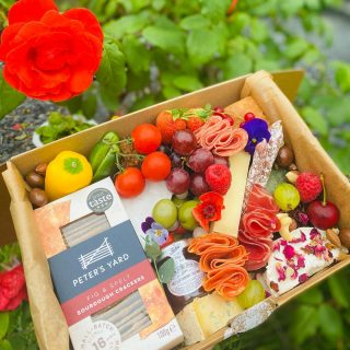 """Who would you share this THREESOME Savoury with?  Our """"Threesome"""" savoury feeds 2-3 people and is priced at £30. They are boxed in our beautifully designed eco boxes from @boxmarttps   Once demolished you can just recycle or compost our UK made ECO BOX and containers!  Today's grazes include Fig and Spelt @petersyard crackers, Brie, Goats Cheese with edible flowers, Stilton, Comte and @cornish.yarg wrapped in nettles, also included is a chunk or pork pie, charcuterie meats, falafels, hot gooseberry chutney from @tiptreephotos , nuts, olives and @driverspickles , chocolate bark and nuts, chocolate almonds and raisins with edible flowers 🧀🍇🍓  #grazingtables #grazingtable #grazingtablesandcheeseboards #grazing #grazingplatter #grazingboard #grazingbox #solihullbusiness #solihull #solihullfood #solihullfoodie #birminghambusiness #birminghamfood #birminghamfoodie #foodtrends #spreadsandbreads #foodporn #platters #partyfood #eventcatering #foodevents #foodgifts  #spreadsandbreadssolihull  #weddingcatering #weddingcaterer #partycatering #partycaterer @solihullcouncil @solihullforsuccess"""