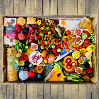 Let's go veggie 🥒🍇🧀🍓  We created a vegetarian The SOCIAL Savoury wooden tray this morning packed with all our favourite vegetarian produce. This size wooden tray feeds 7-9 people and is £120  Today's graze includes a selection of crackers with some pink peppercorn from @petersyard , eight varieties of cheese: goats cheese with edible rose petals, Brie, chilli Mexican cheddar, port salut, @cornish.yarg wrapped in edible nettles, cambozola, Stilton and @jarlsberg_   We also included a variety of vegetarian savouries with a @higgidy Higgidy Roasted Sweet Potato & Feta Pie, mini vegetable pies, @higgidy Porcini Mushroom & Spinach Vegan Rolls, falafels and @higgidy Cheddar & Spinach Mini Muffins. There is a large ramekin packed with olives and @driverspickles , fresh fruits and vegetables and a ramekin of hummus with stuffed cherry peppers, @tiptreephotos chilli jam and a mini pot of @matersandco honey with drizzle stick 🍇🍓🧀🥒  #grazingtables #grazingtable #grazingtablesandcheeseboards #grazing #grazingplatter #grazingboard #grazingbox #solihullbusiness #solihull #solihullfood #solihullfoodie #birminghambusiness #birminghamfood #birminghamfoodie #foodtrends #spreadsandbreads #foodporn #platters #partyfood #eventcatering #foodevents #foodgifts  #spreadsandbreadssolihull  #weddingcatering #weddingcaterer #partycatering #partycaterer @solihullcouncil @solihullforsuccess