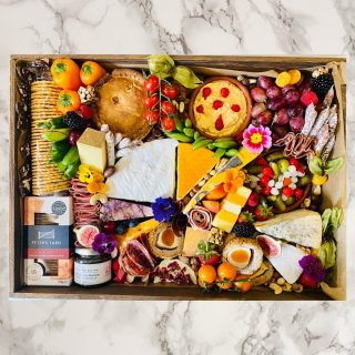 The SOCIAL Savoury 🧀🍇  We recommend this size graze 7-9 people, priced at £95  Our wooden Grazing Trays manufactured locally in the West Midlands create a rustic platform for us to create the perfect grazing tray for you.  These boxes are perfect for special occasions like birthdays, date nights, business meetings, cheese course at your wedding, training courses or on occasions you want to make that little bit more special. Bonus you get to keep the wooden tray, glass jars and bowls – who doesn't love tableware!  We love to personalise so let us know if it's for an occasion or if you want to theme its contents or personalise the wooden tray with someone's name or special date etc we laser engrave in-house for an additional £5.  #grazingtables #grazingtable #grazingtablesandcheeseboards #grazing #grazingplatter #grazingboard #grazingbox #solihullbusiness #solihull #solihullfood #solihullfoodie #birminghambusiness #birminghamfood #birminghamfoodie #foodtrends #spreadsandbreads #foodporn #platters #partyfood #eventcatering #foodevents #foodgifts  #spreadsandbreadssolihull  #weddingcatering #weddingcaterer #partycatering #partycaterer @solihullcouncil @solihullforsuccess