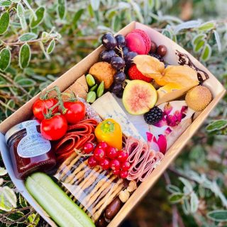 "Frosty morning graze ❄️ Our most popular graze during lockdown is our ""threesome"" mashup of sweet and savoury. Today's grazes include a selection of crackers, pot of olives and pickles, hot gooseberry chutney, pork pie, falafels, charcuterie meats, fresh fruit and vegetables. We've include Brie, Stilton, Jarlsberg and rose petal Goats Cheese. There are also treats, a mini cupcake, brownie, macron, chocolate bark, nuts and chocolate coated nuts and raisins! #grazingtables #grazingtable #grazingtablesandcheeseboards #grazing #grazingplatter #grazingboard #grazingbox #solihullbusiness #solihull #solihullfood #solihullfoodie #birminghambusiness #birminghamfood #birminghamfoodie #foodtrends #spreadsandbreads #foodporn #platters #partyfood #eventcatering #foodevents #foodgifts #spreadsandbreadssolihull #weddingcatering #weddingcaterer #partycatering #partycaterer @solihullcouncil @solihullforsuccess"