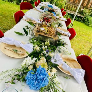 """Picnic Grazing @sellymanor gardens for today's hen party 🍃🌸🌿🌹  Today we created a """"The All-Out"""" savoury platter board, it feeds 10-14 people.  The customer upgraded the cracker box to one of our wooden trays, and requested it included tiger bread and butter. So we included @isignyuk butter with three toppings: chilli flakes, pink seat salt and edible rose petals.   They also had a YOU DESSERT IT wooden dessert graze feeds 5-9 people and is priced at £65 and requested afternoon tea style so we included scones with a pot of @tiptreephotos strawberry jam and @roddas_cream clotted cream.  We also add wooden palm leaf, biodegradable cutlery and plates for £1.20 per person, they upgraded to beautiful linen napkins, and we decorated the table with beautiful flowers!  #grazingtables #grazingtable #grazingtablesandcheeseboards #grazing #grazingplatter #grazingboard #grazingbox #solihullbusiness #solihull #solihullfood #solihullfoodie #birminghambusiness #birminghamfood #birminghamfoodie #foodtrends #spreadsandbreads #foodporn #platters #partyfood #eventcatering #foodevents #foodgifts  #spreadsandbreadssolihull  #weddingcatering #weddingcaterer #partycatering #partycaterer @solihullcouncil @solihullforsuccess"""