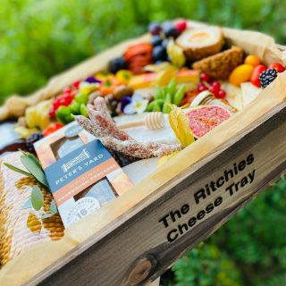 The Ritchie's Cheese Tray 🧀🍓🍇  This morning we created one of our wooden The POSSE Savoury Trays, which we estimate feeds 4-6 people and are priced at £80. We laser engraved in-house a personalised message, this costs an additional £5.  This graze included two varieties of crackers with @petersyard , pork pie, @tiptreephotos chilli chutney, @comtesse_du_barry pate, fresh fruits and vegetables, @thejollyhog scotch egg, @matersandco English honey with drizzle stick, olives and @driverspickles , charcuterie meats, nuts and chocolate almonds, raisins and bark. The selection of cheese included: Brie, Stilton, @jarlsberg_ , Manchego, @mexicanacheese , goats cheese, cambozola.  #grazingtables #grazingtable #grazingtablesandcheeseboards #grazing #grazingplatter #grazingboard #grazingbox #solihullbusiness #solihull #solihullfood #solihullfoodie #birminghambusiness #birminghamfood #birminghamfoodie #foodtrends #spreadsandbreads #foodporn #platters #partyfood #eventcatering #foodevents #foodgifts  #spreadsandbreadssolihull  #weddingcatering #weddingcaterer #partycatering #partycaterer @solihullcouncil @solihullforsuccess
